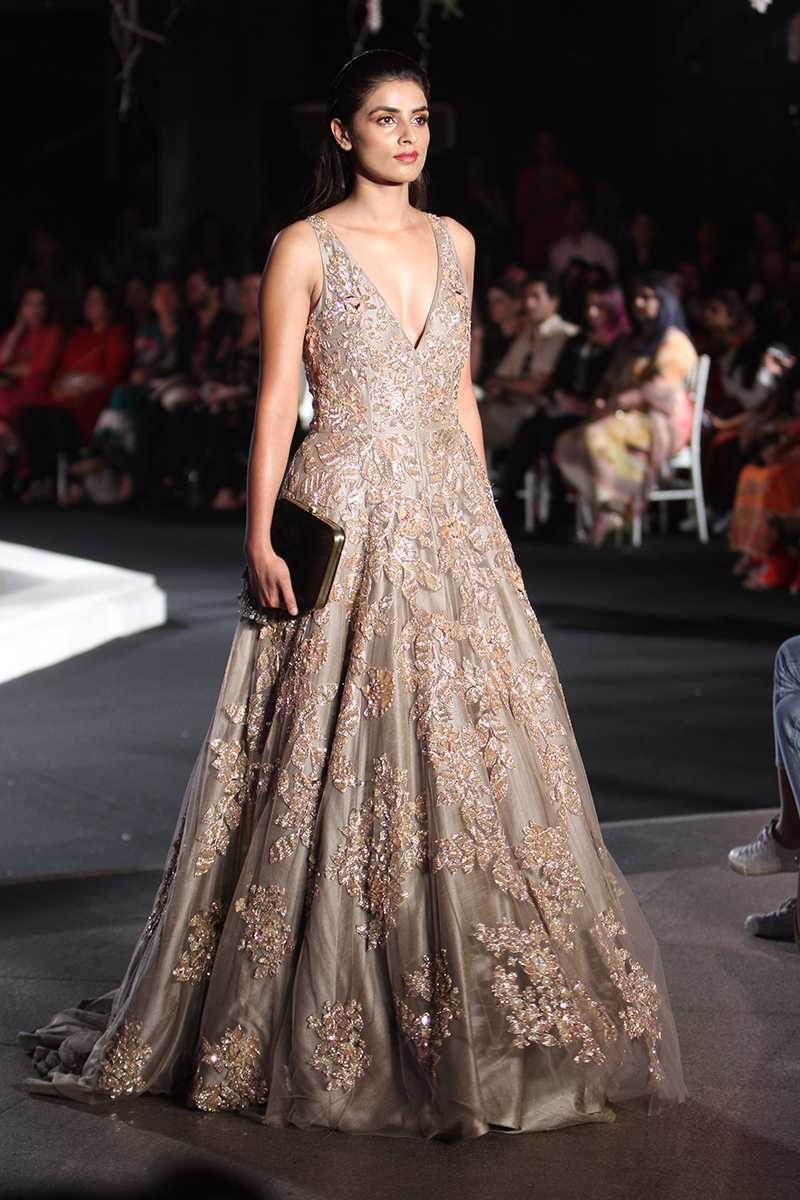 a model in a beautiful silver-grey gown